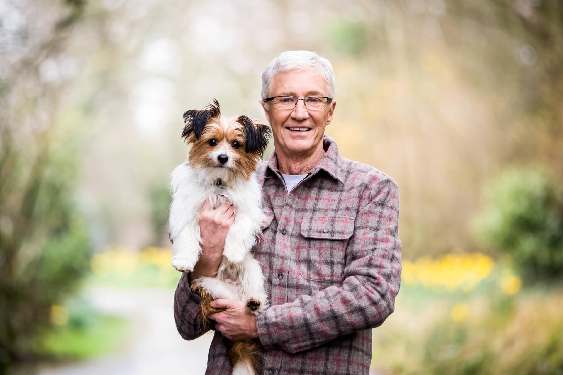 Paul o Grady holding his puppy