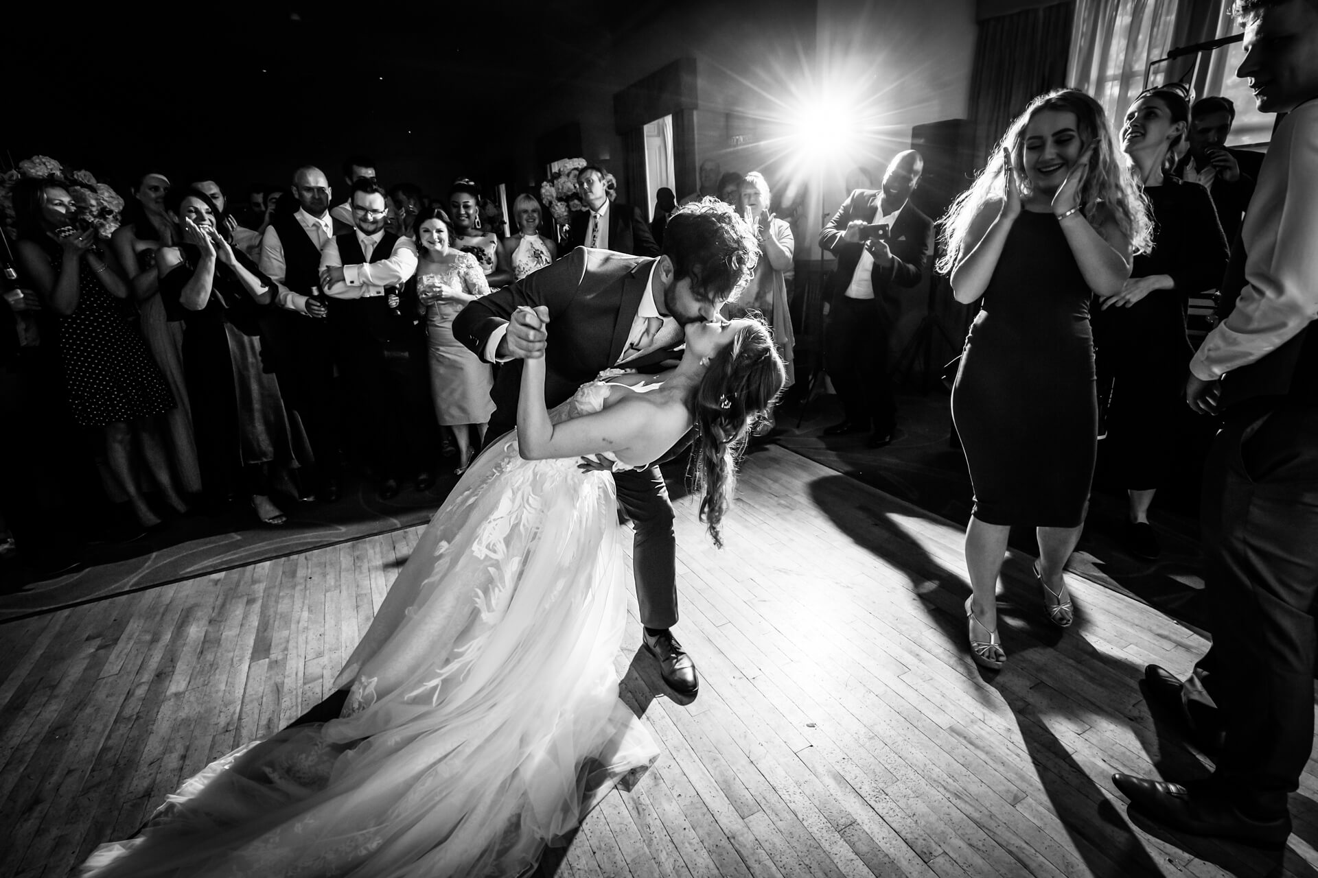 the groom dips the bride during their first dance