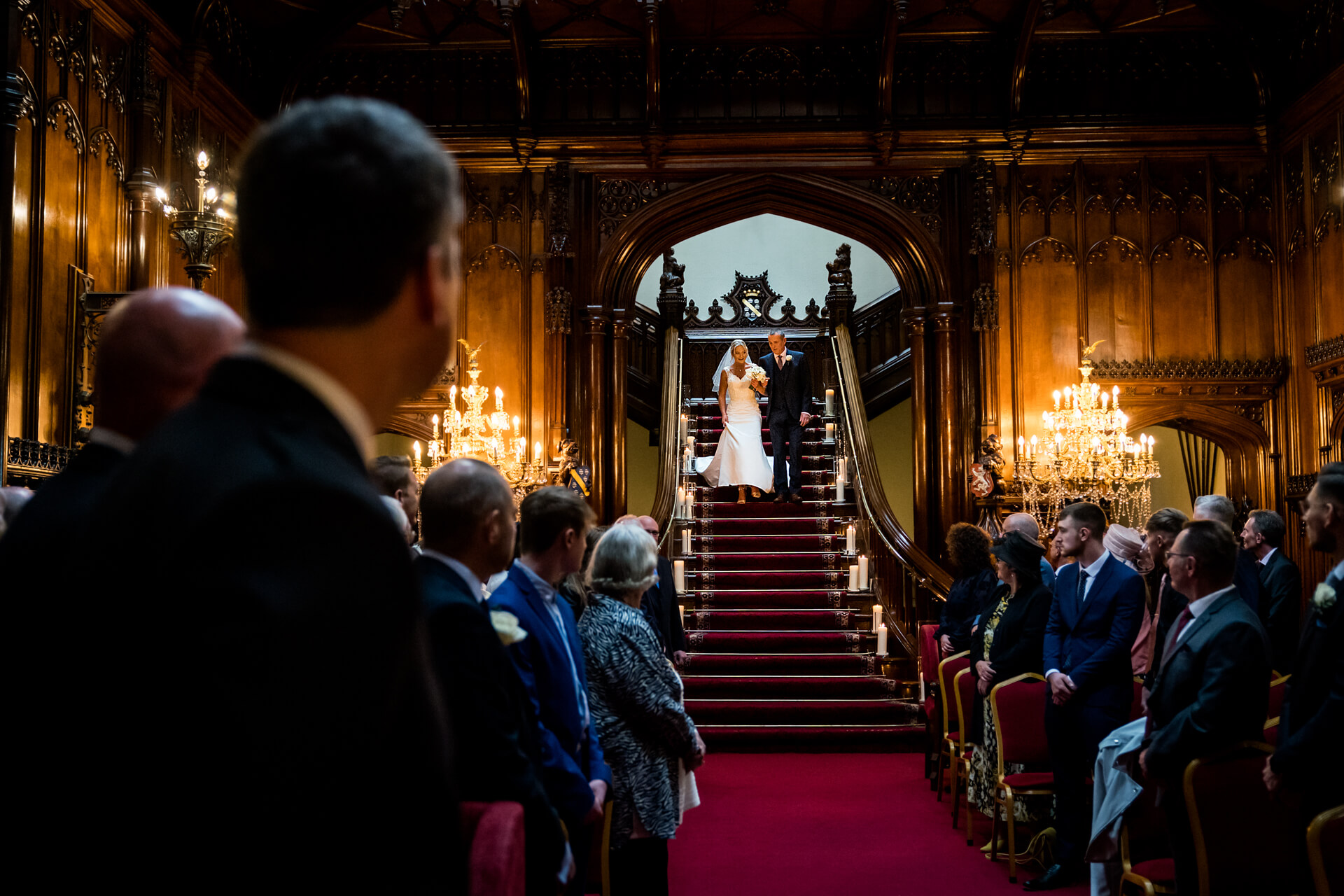 bride and her father walking down the grand staircase at Allerton Castle