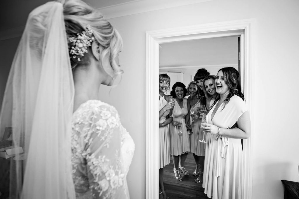 Lake District wedding photography- bride reveal to the bridesmaids