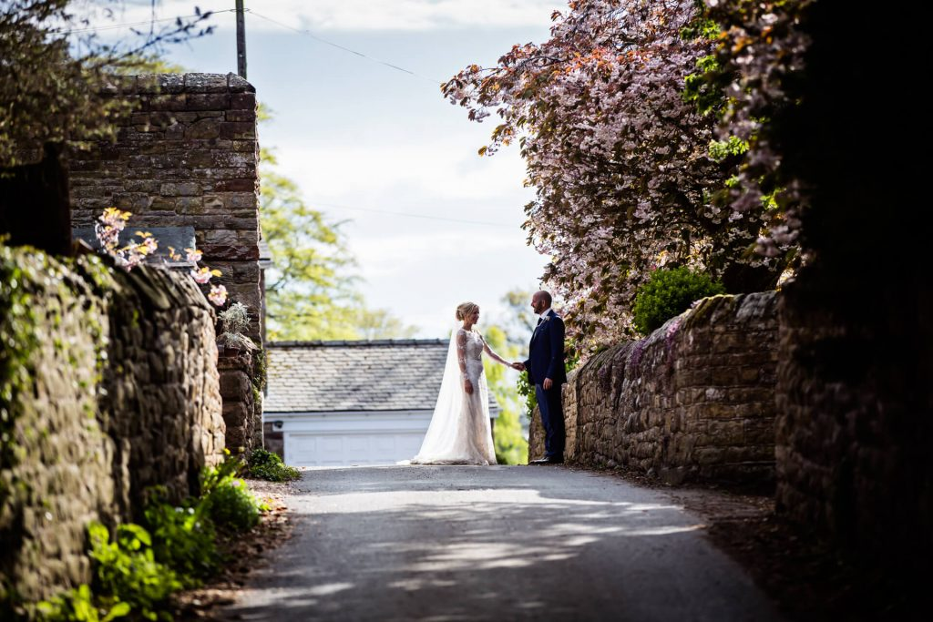 Lake District Wedding Photographer -couple under blossoms