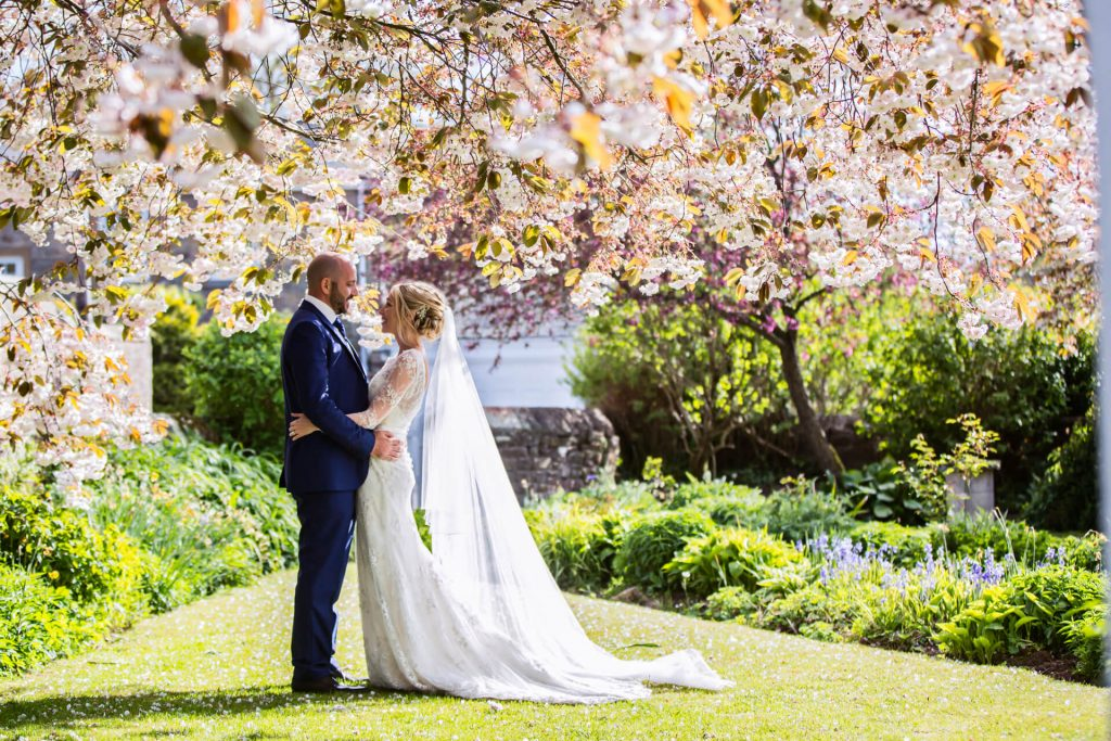 Lake District Wedding Photographer - couple under blossom trees