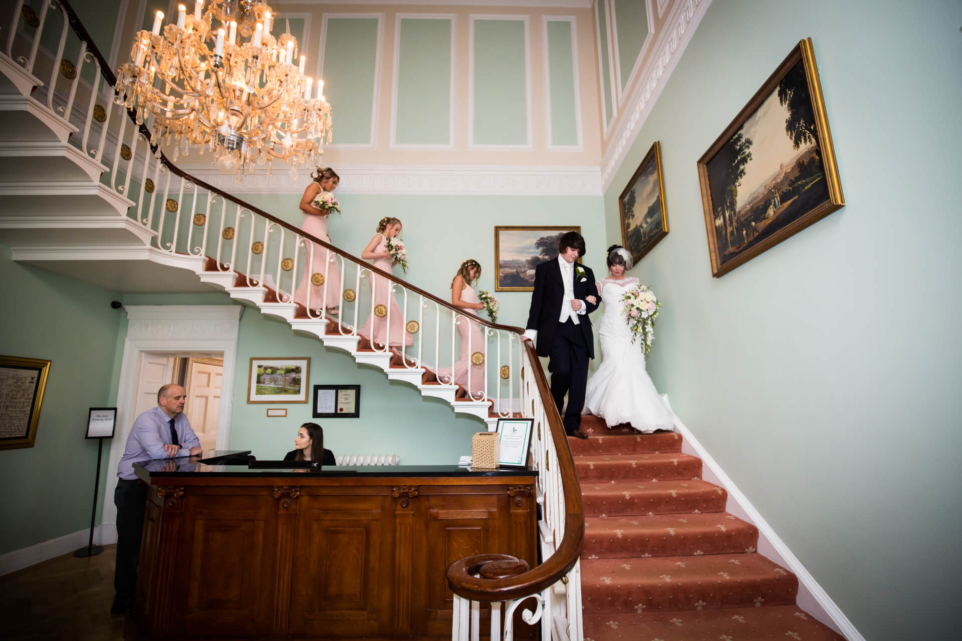 Bride descends the stairs at Hazlewood Castle