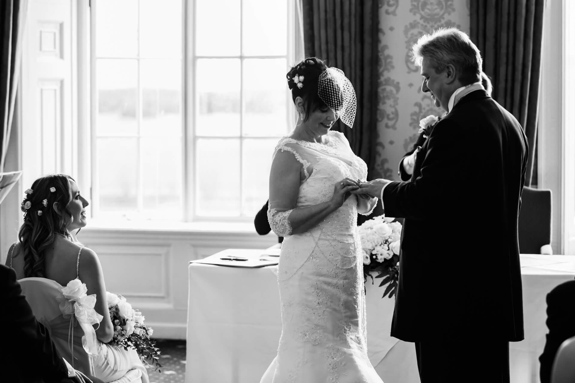 Hazlewood Castle wedding photographer - wedding couple say their vows