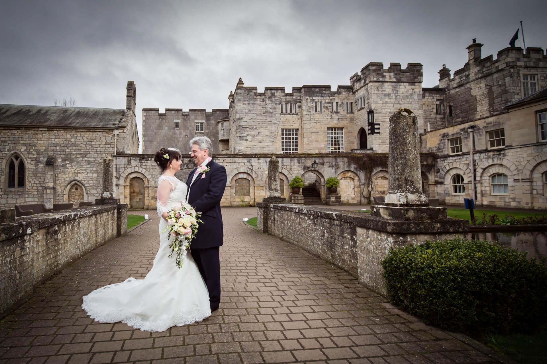 Bride and groom outside Hazlewood Castle