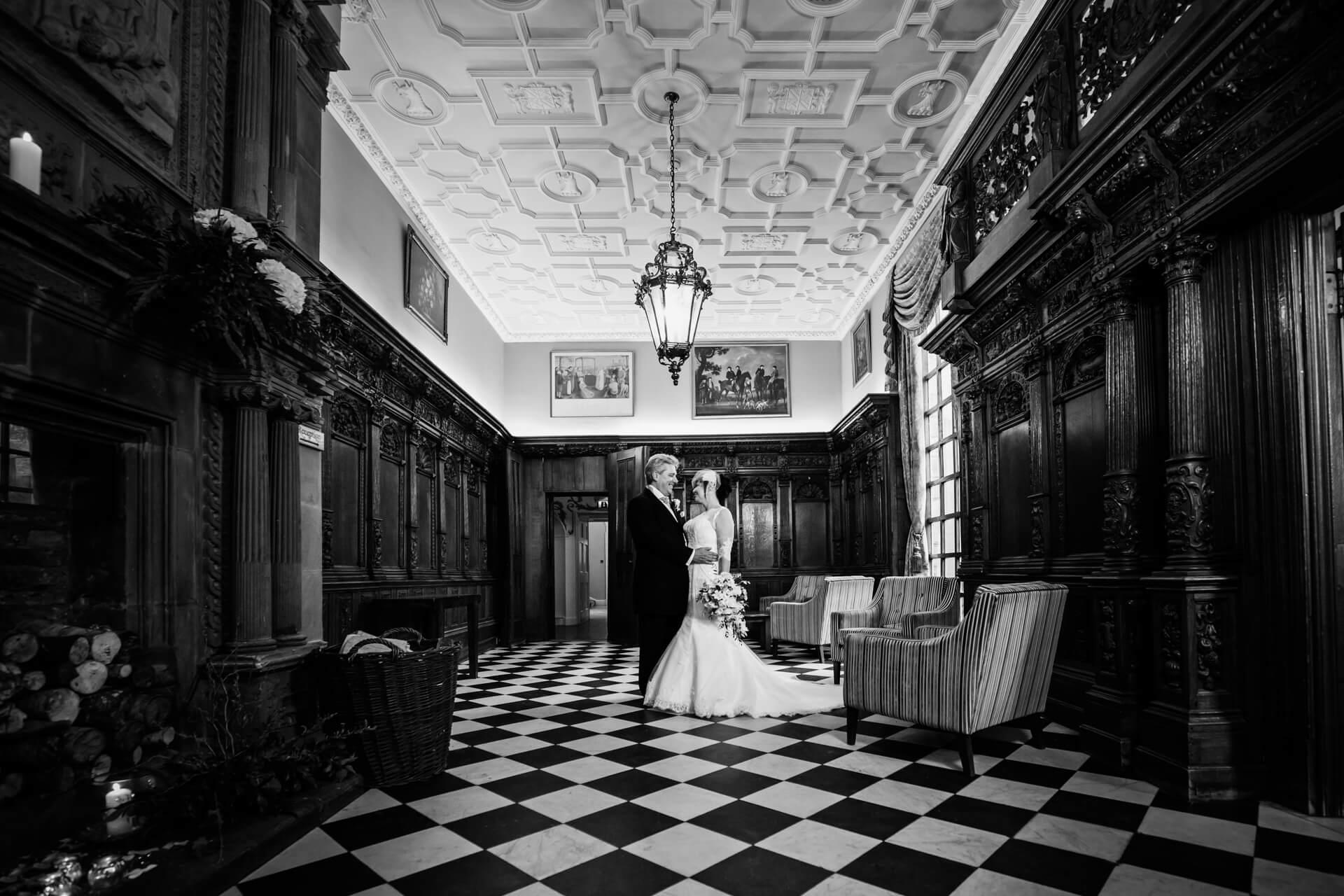 Hazlewood Castle wedding photographer - wedding couple inside the castle