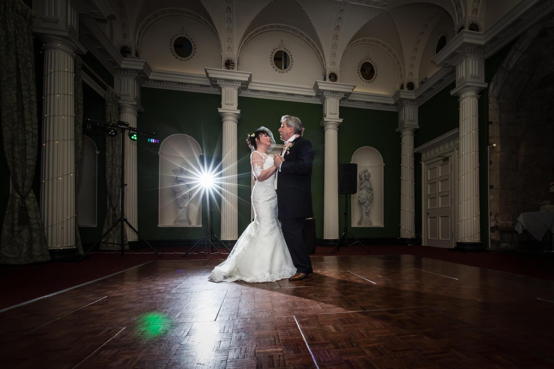 Hazlewood Castle wedding photographer - wedding couple's first dance