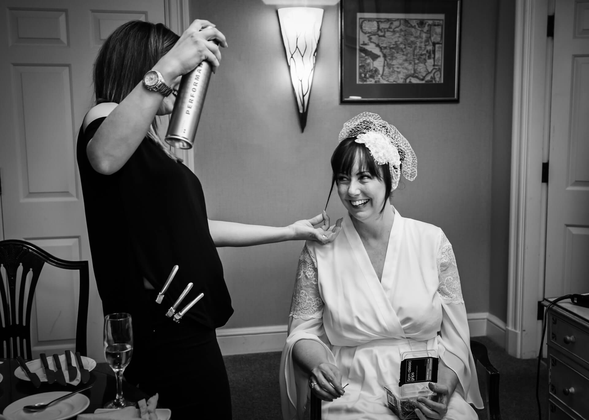 Hazlewood Castle wedding photographer - bride getting her hair done