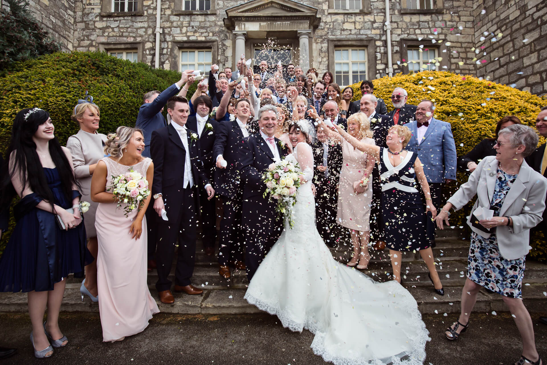 Bride and groom showered with confetti at Hazlewood Castle