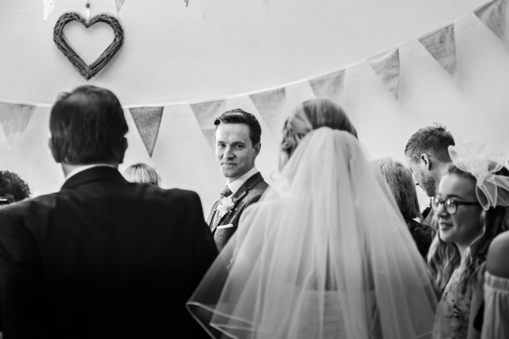 Hornington Manor Wedding Photography - groom seeing the bride for the first time