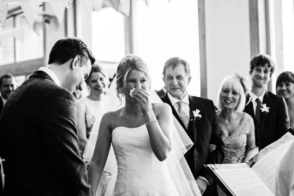 Hornington Manor Wedding Photography - bride laughing during the ceremony