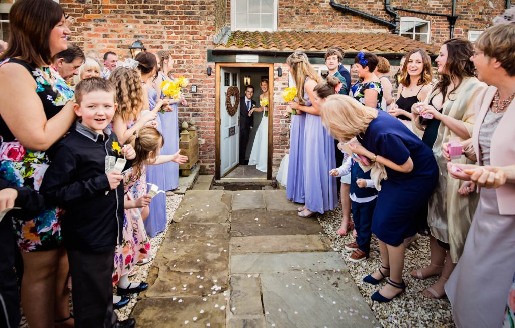 couple about to walk the confetti line at Hornington Manor