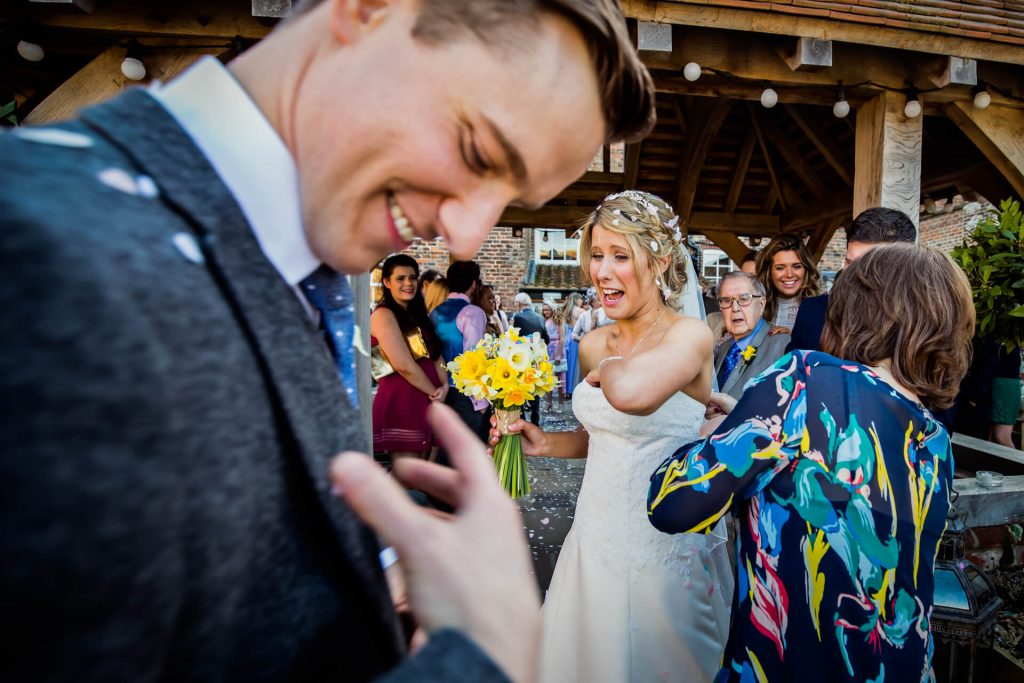 Wedding couple showered in confetti at Hornington Manor