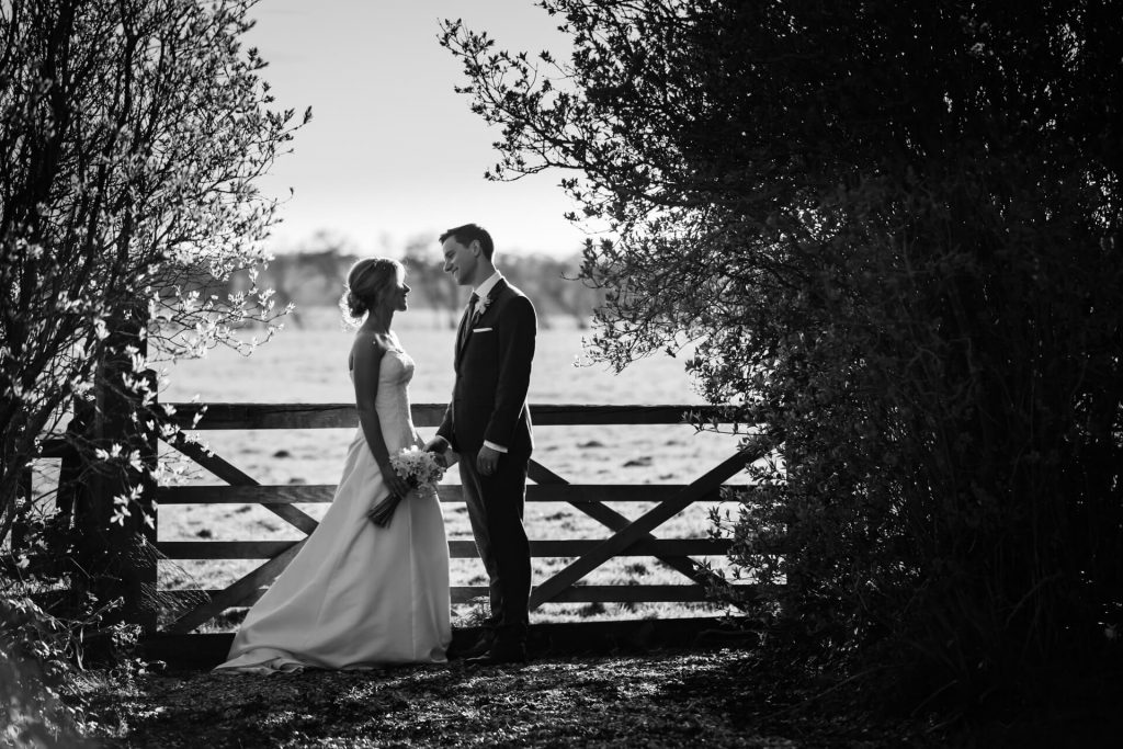 Hornington Manor Wedding Photography - couple chatting by a fence