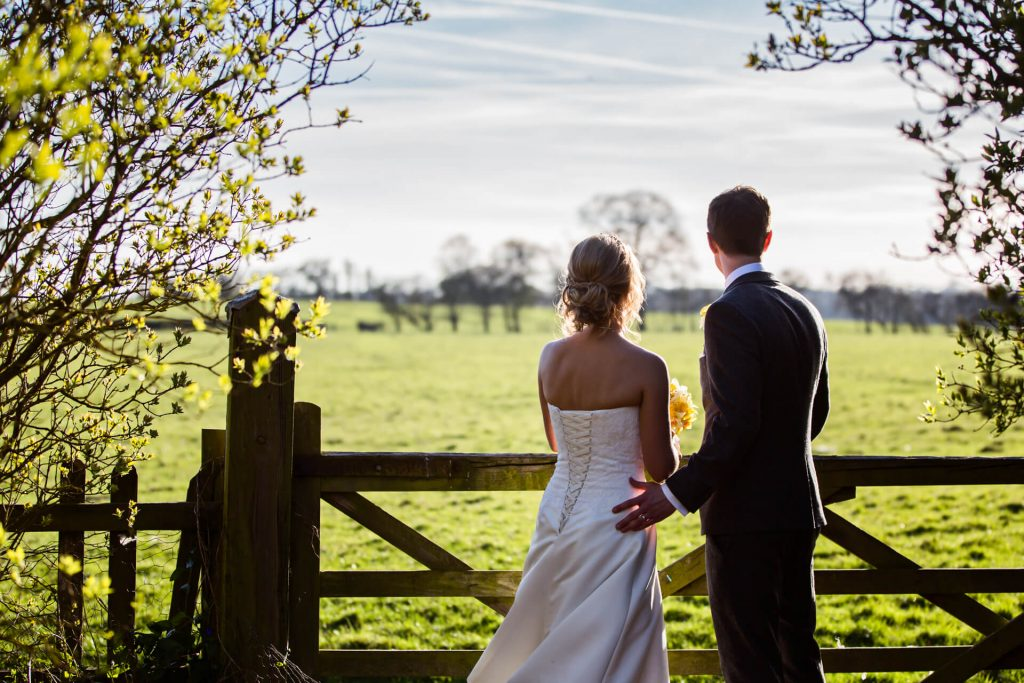 Wedding couple looking at the sunset at Hornington Manor