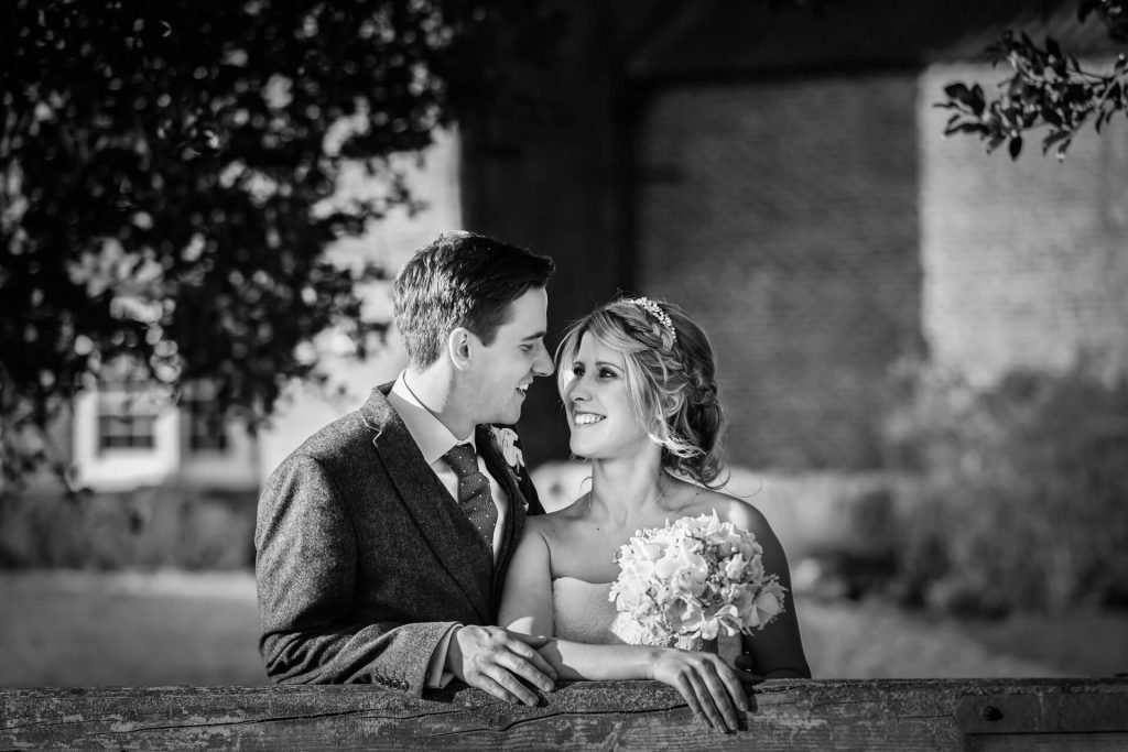 couple leaning on gate at Hornington Manor