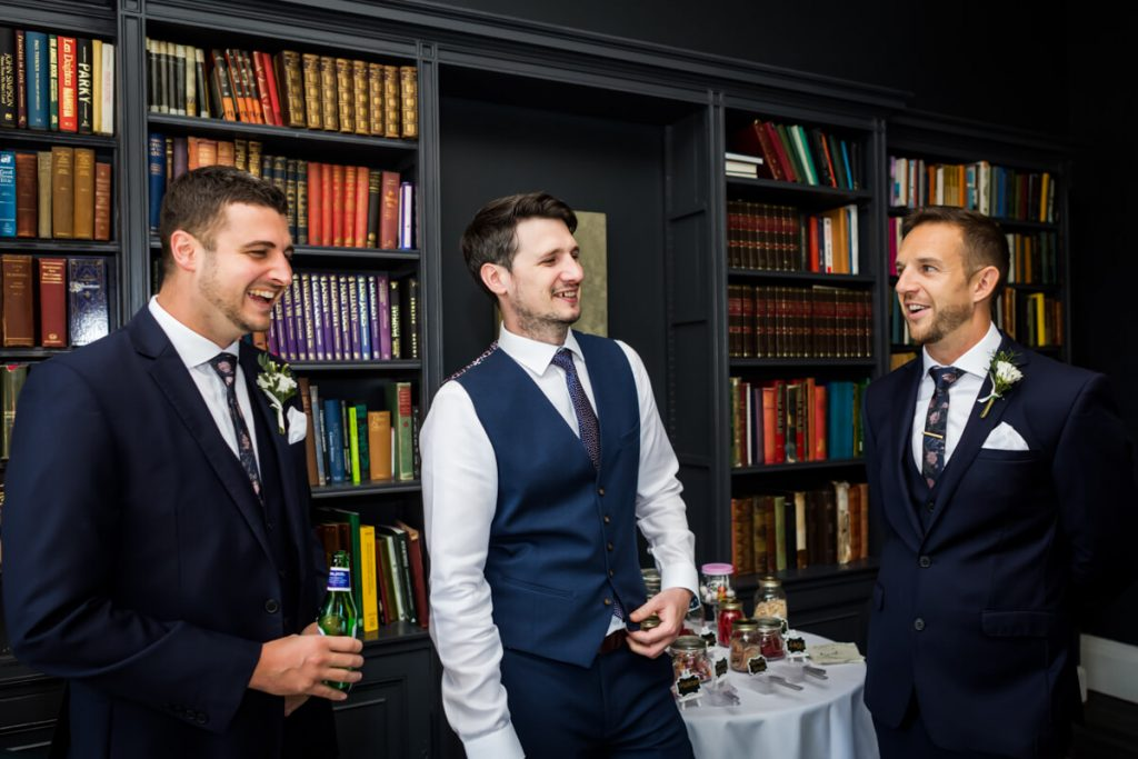 groom and his groomsmen in the library at Saltmarshe Hall