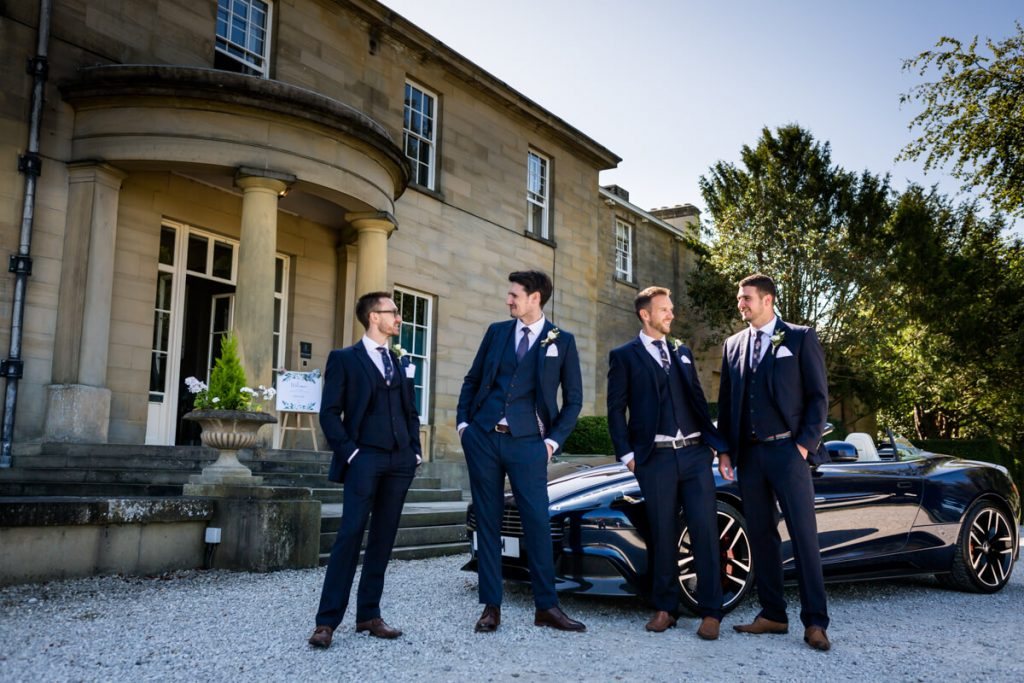 Groomsmen outside Saltmarshe Hall chatting