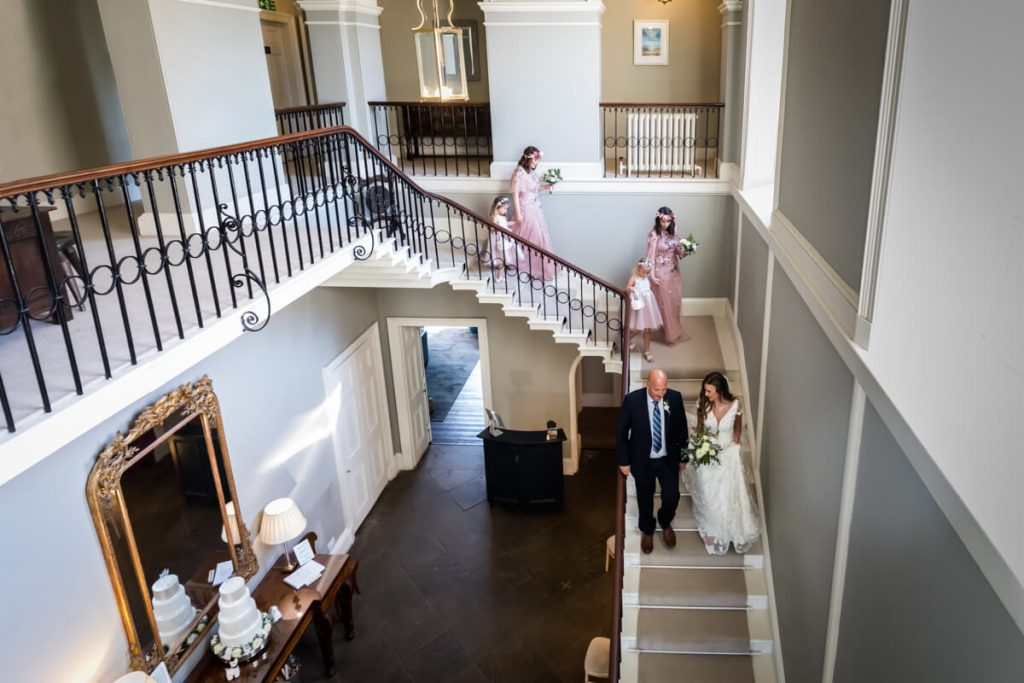 bridal party descending the stairs at Saltmarshe Hall