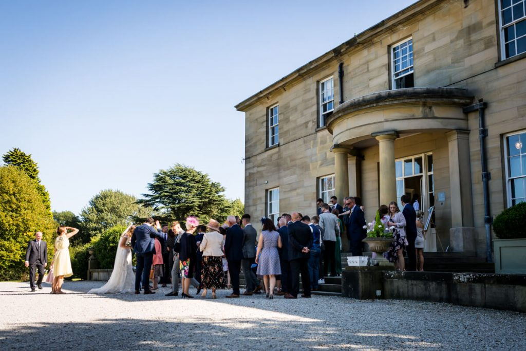 view of the guests gathered outside Saltmarshe Hall