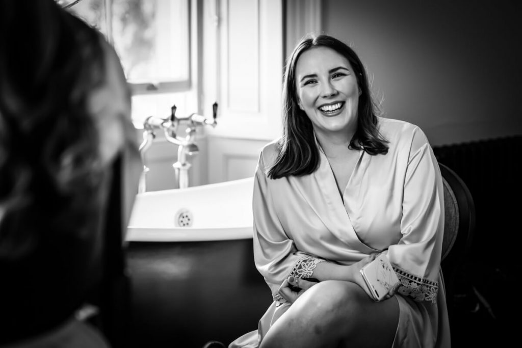 bridesmaid laughing during bridal preparations