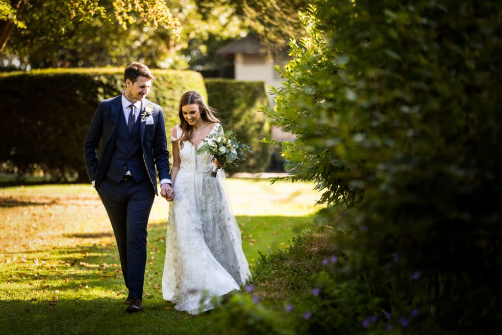Saltmarshe Hall wedding photography - bride and groom walking in the gardens