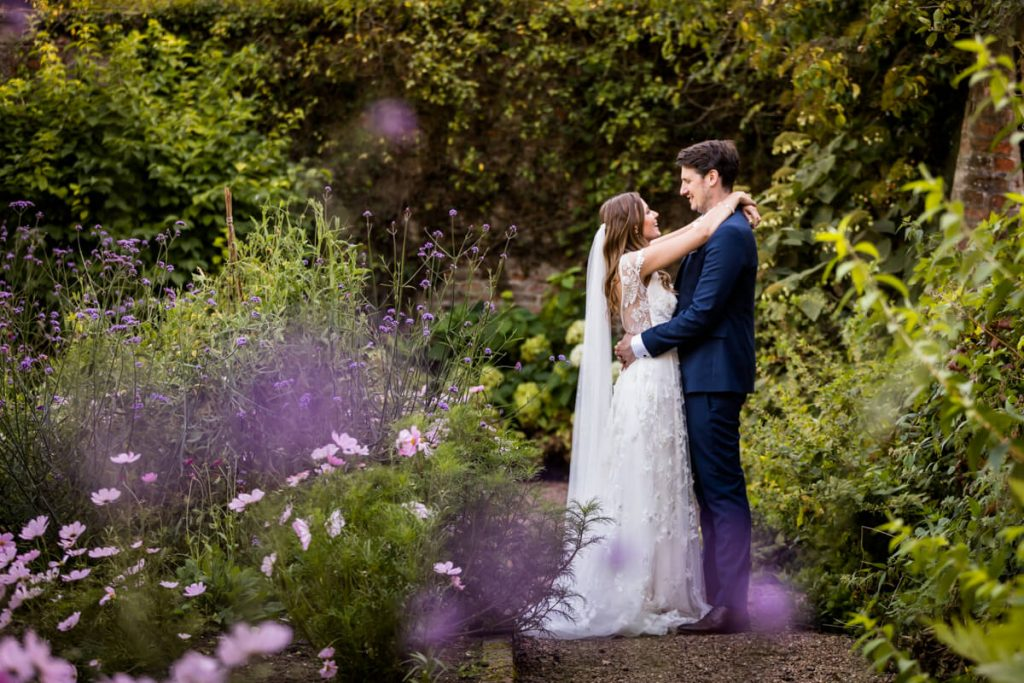 Saltmarshe Hall wedding photography- bride and groom embracing in the gardens