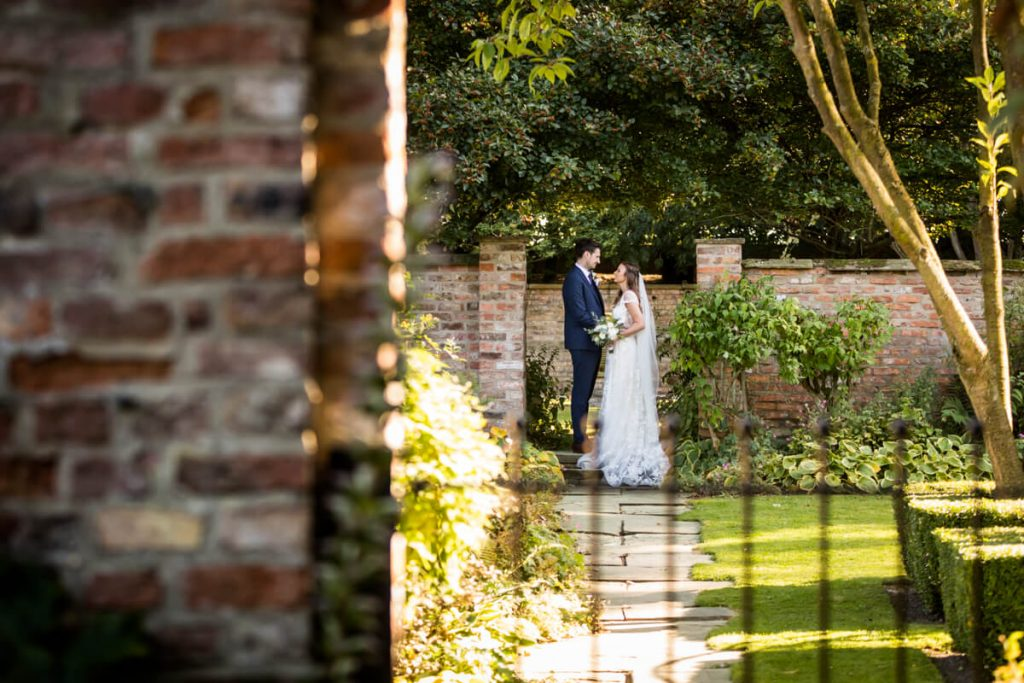Portrait of the wedding couple in Saltmarshe Hall grounds