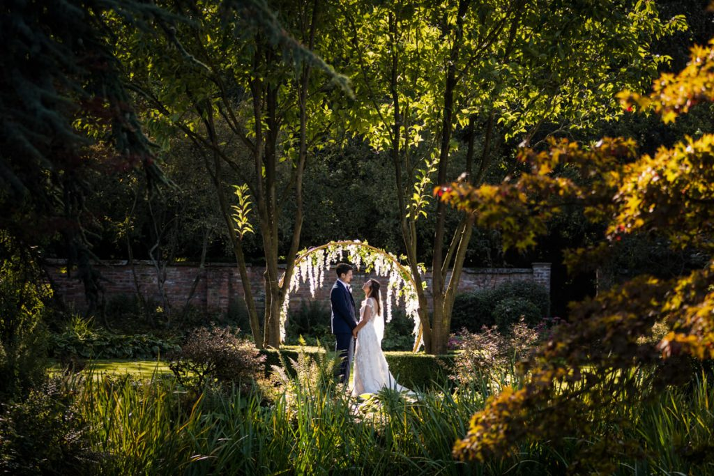 wedding couple holding hands in Saltmarshe Hall gardens