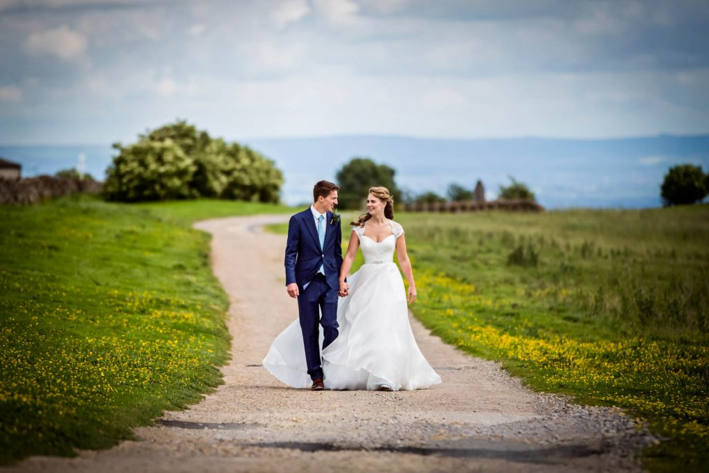 Wedding couple walking in the Yorkshire Dales
