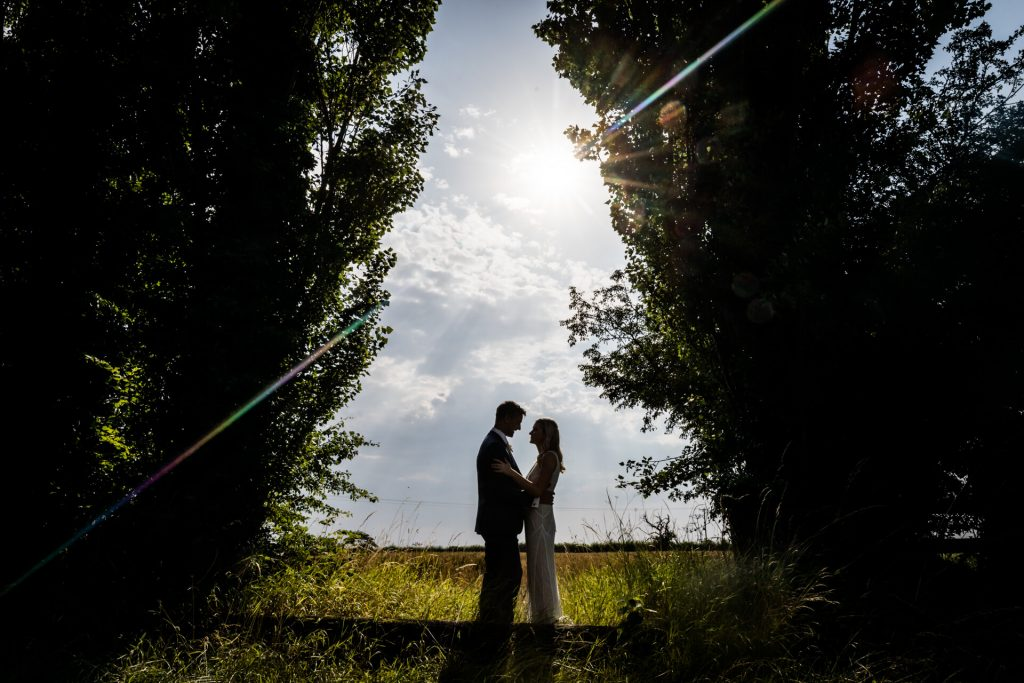 wedding couple portrait under some trees