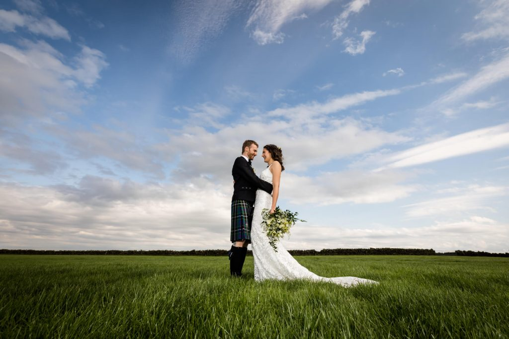 Wedding couple in a Yorkshire Dales field