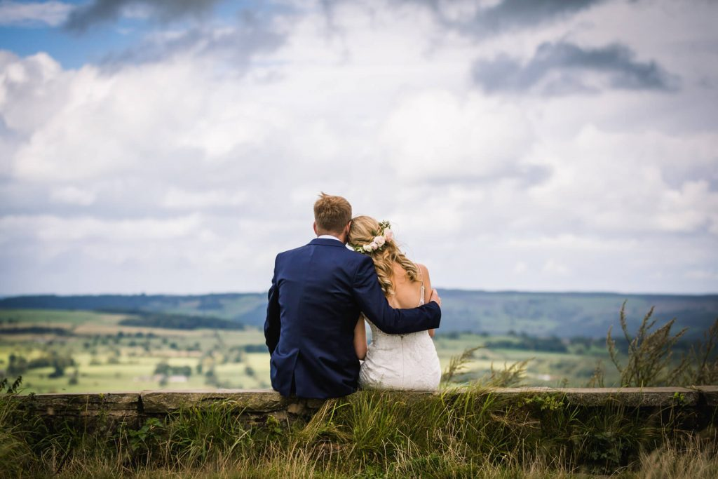 Couple sitting looking at a Yorkshire view