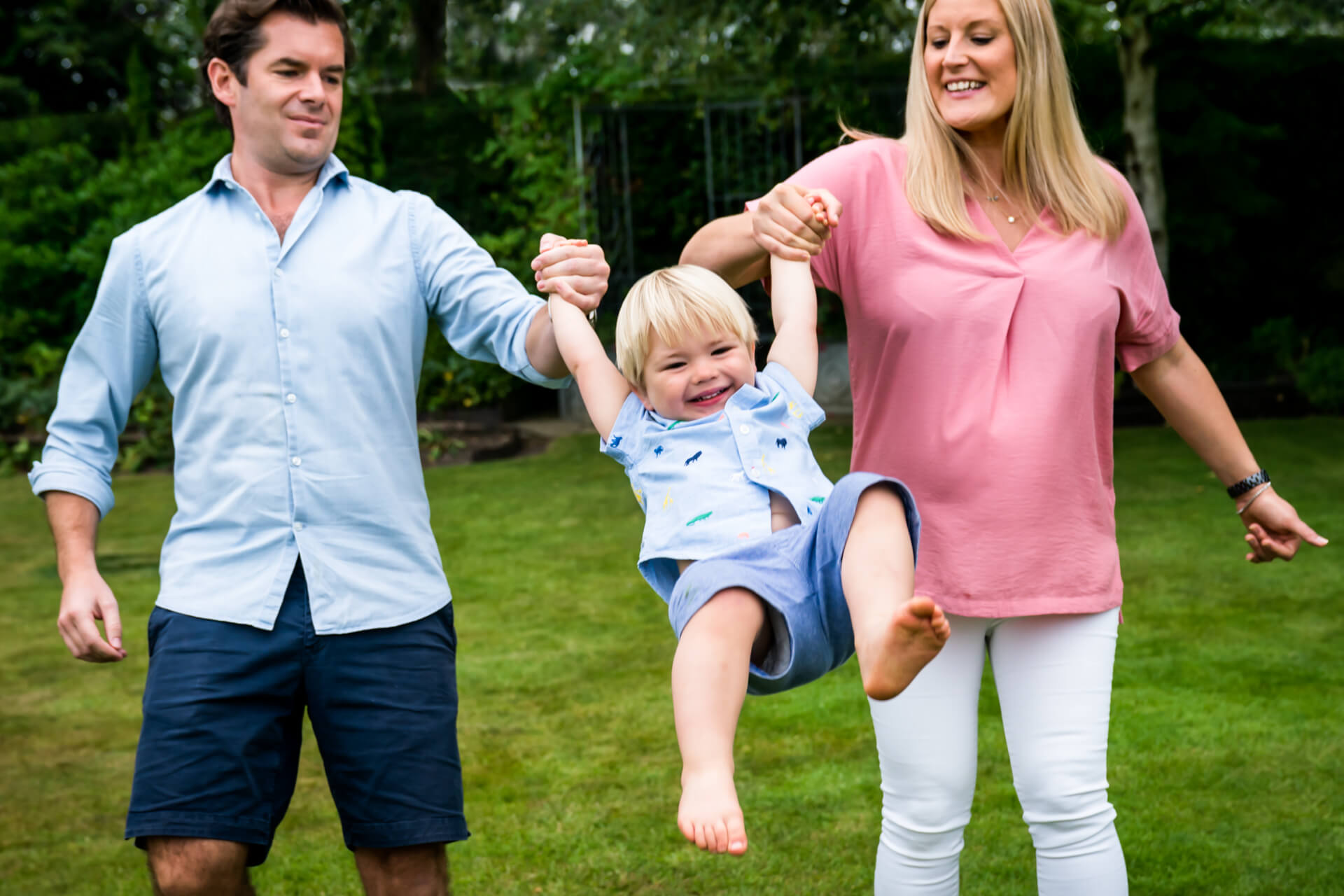 couple swinging their son