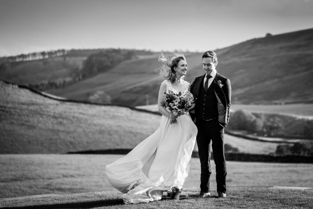 wedding couple standing in front of a yorkshire dales view