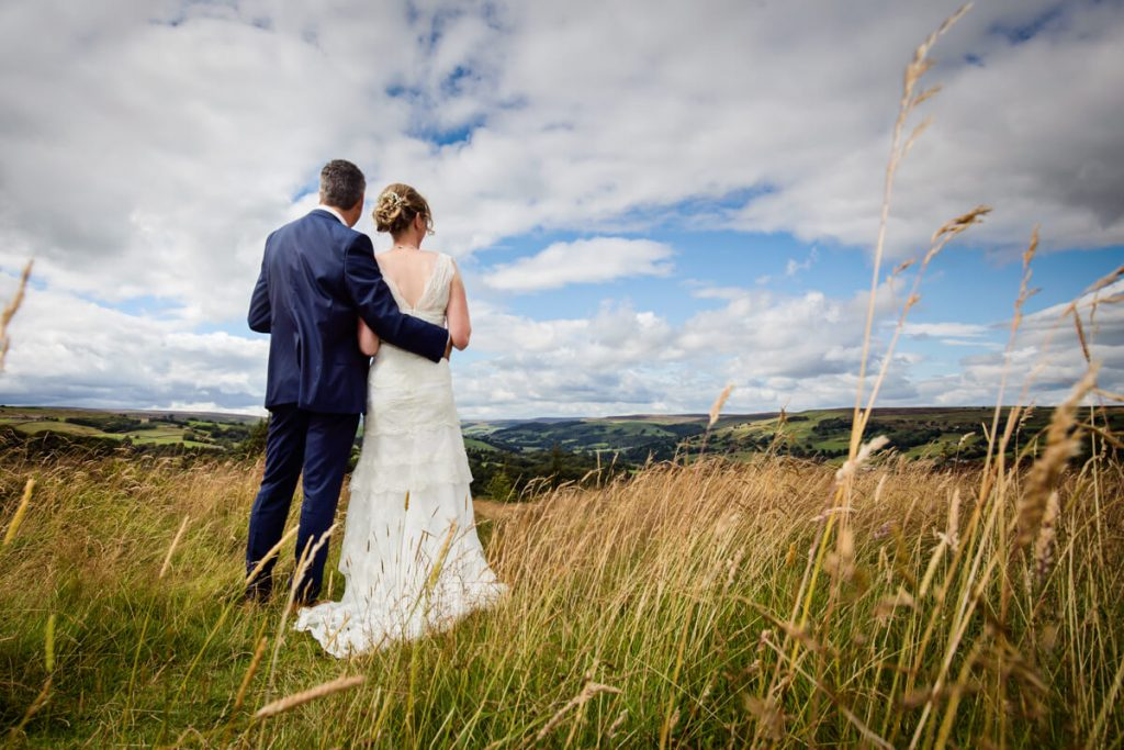 bride and groom looking at a yorkshire dales view