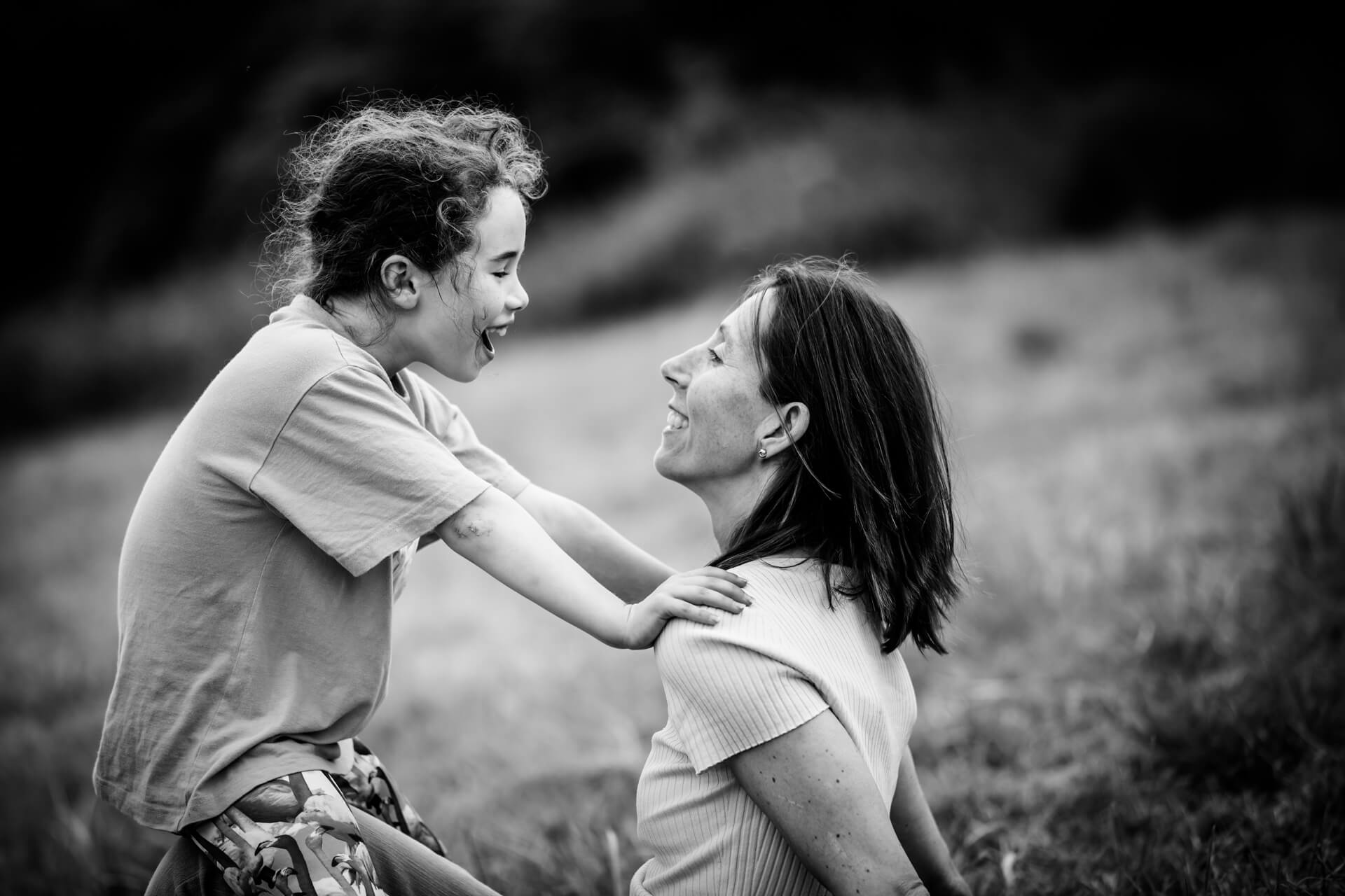 child and her mum laughing together
