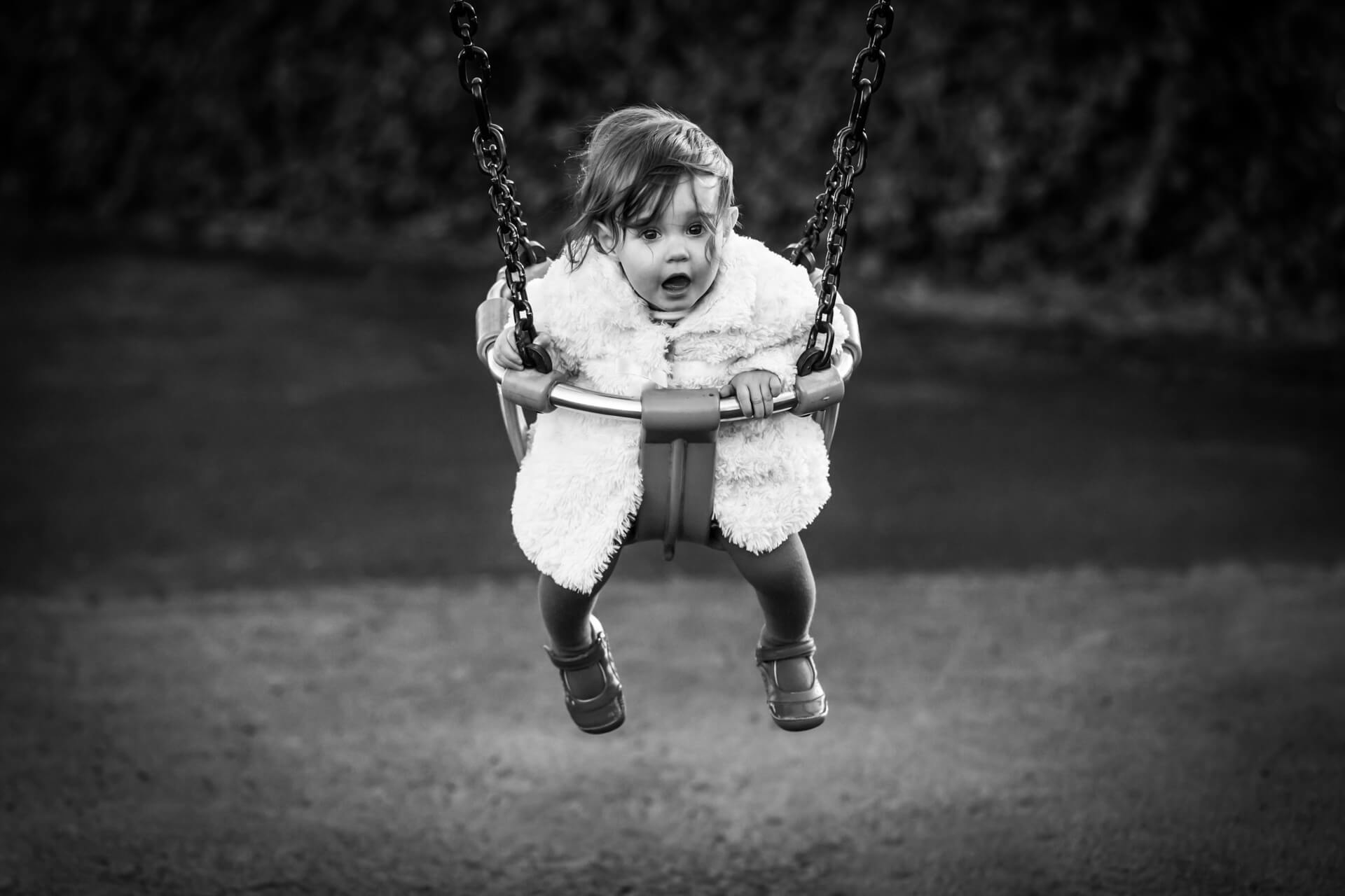 toddler swinging on a swing