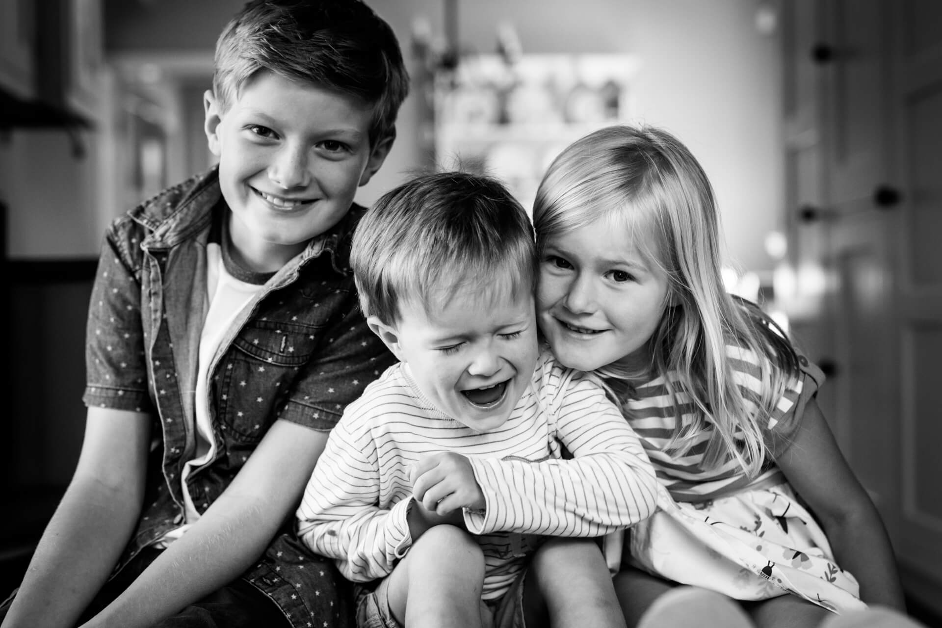siblings laughing together