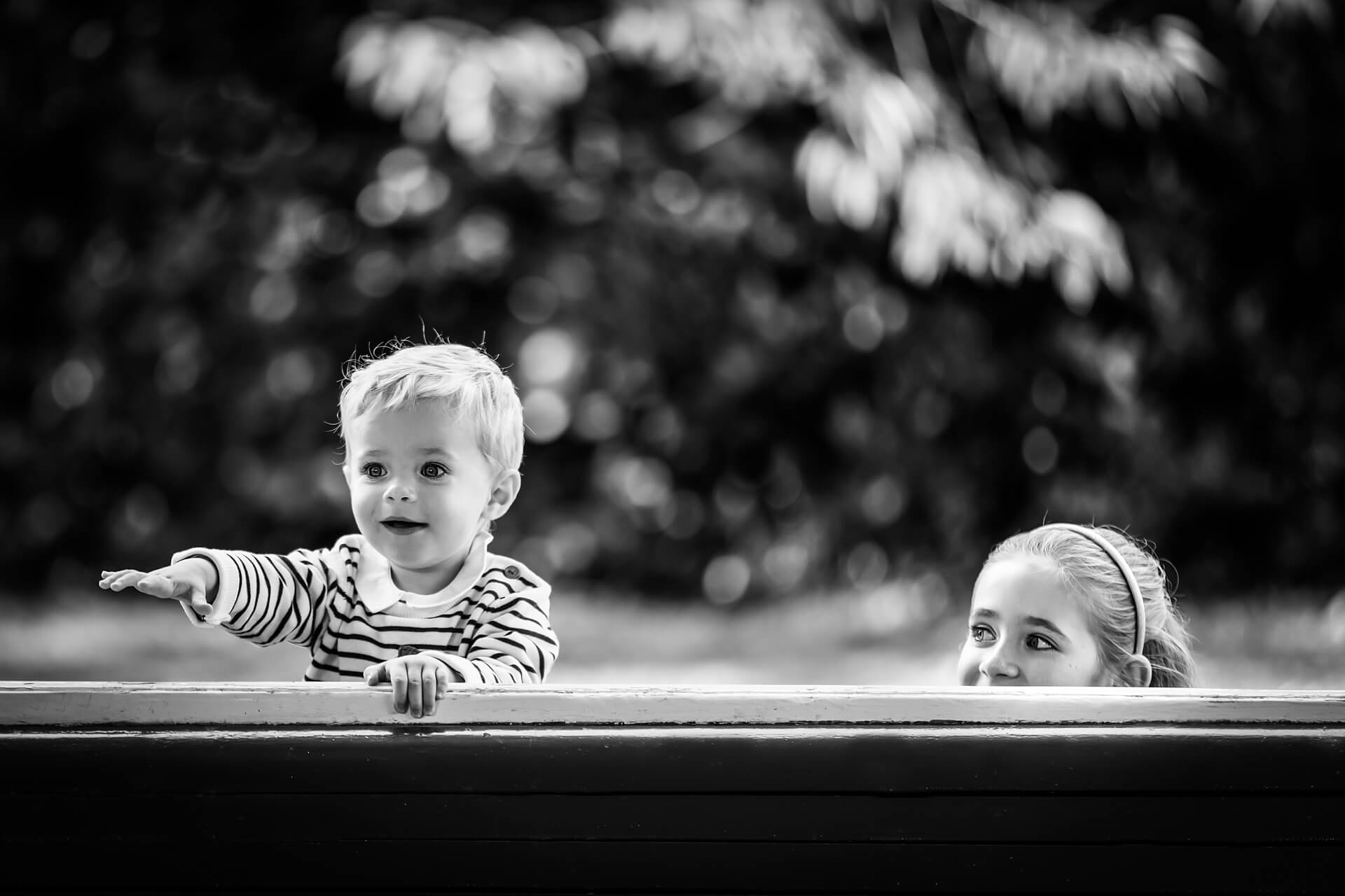 yorkshire portrait photographer - small and boy peering over a fence