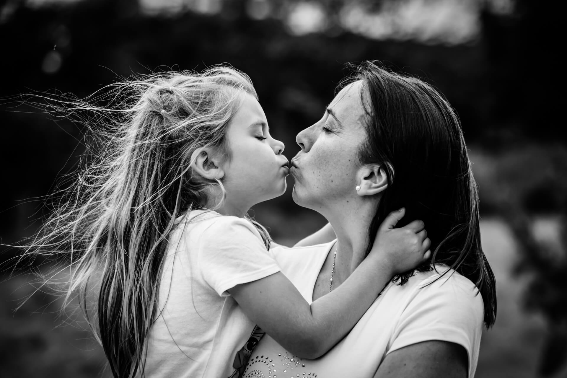 mother and her daughter kissing