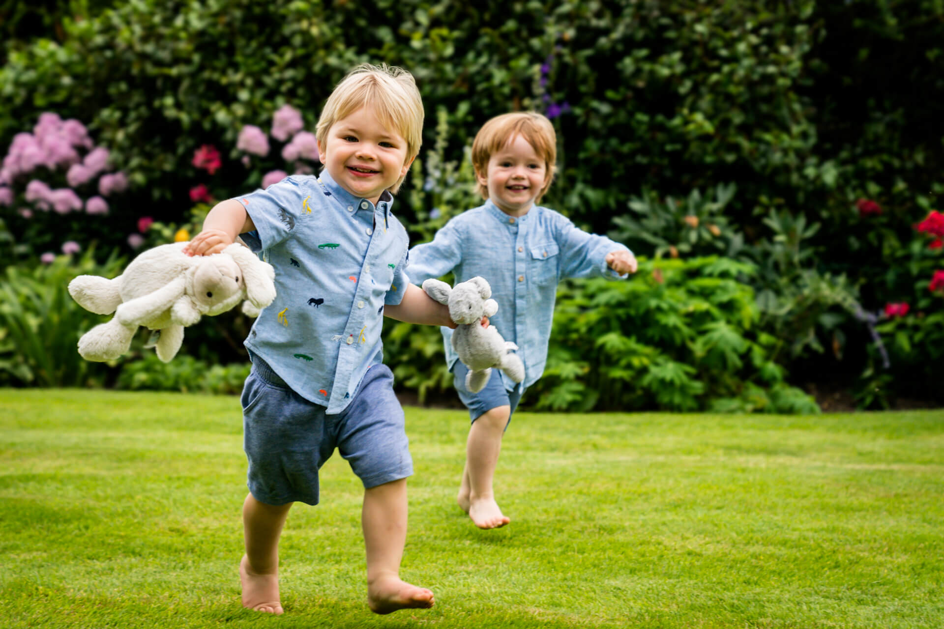 two boys running in their garden together