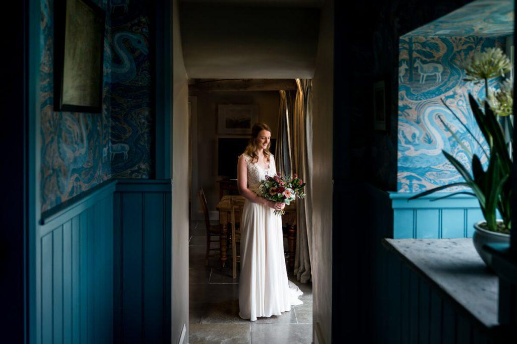 bride looking at her flowers