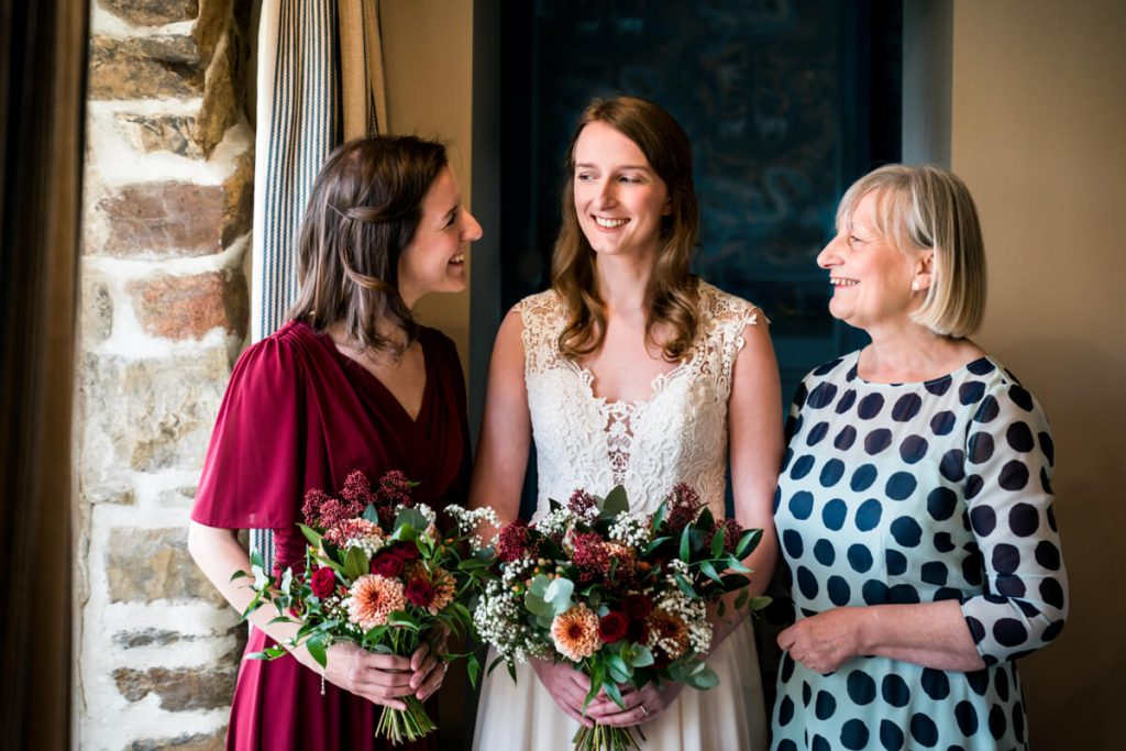 bride with her sister and mum