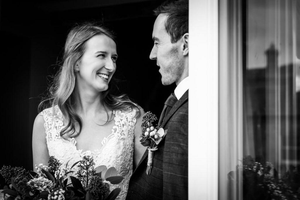 bride and groom in the doorway