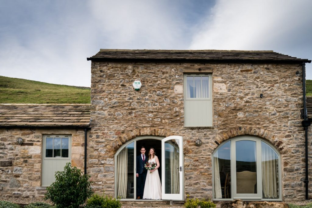 bride and groom portrait in a doorway at telfit farm
