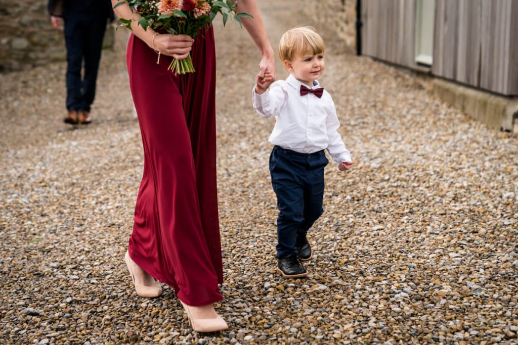 pageboy walking with the bridesmaid