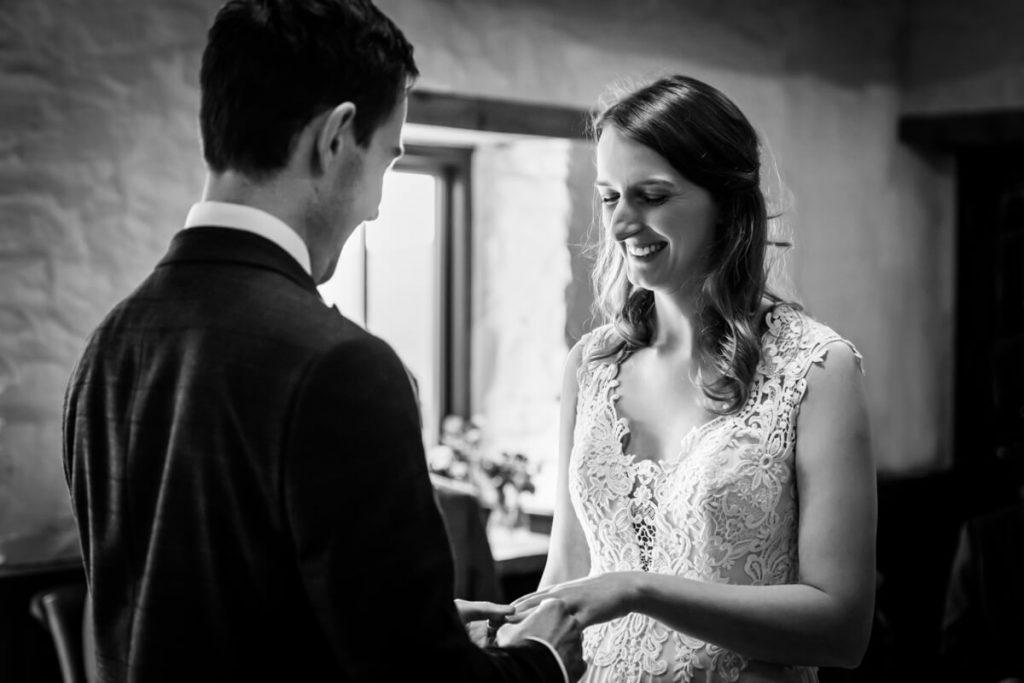 bride and groom exchange rings