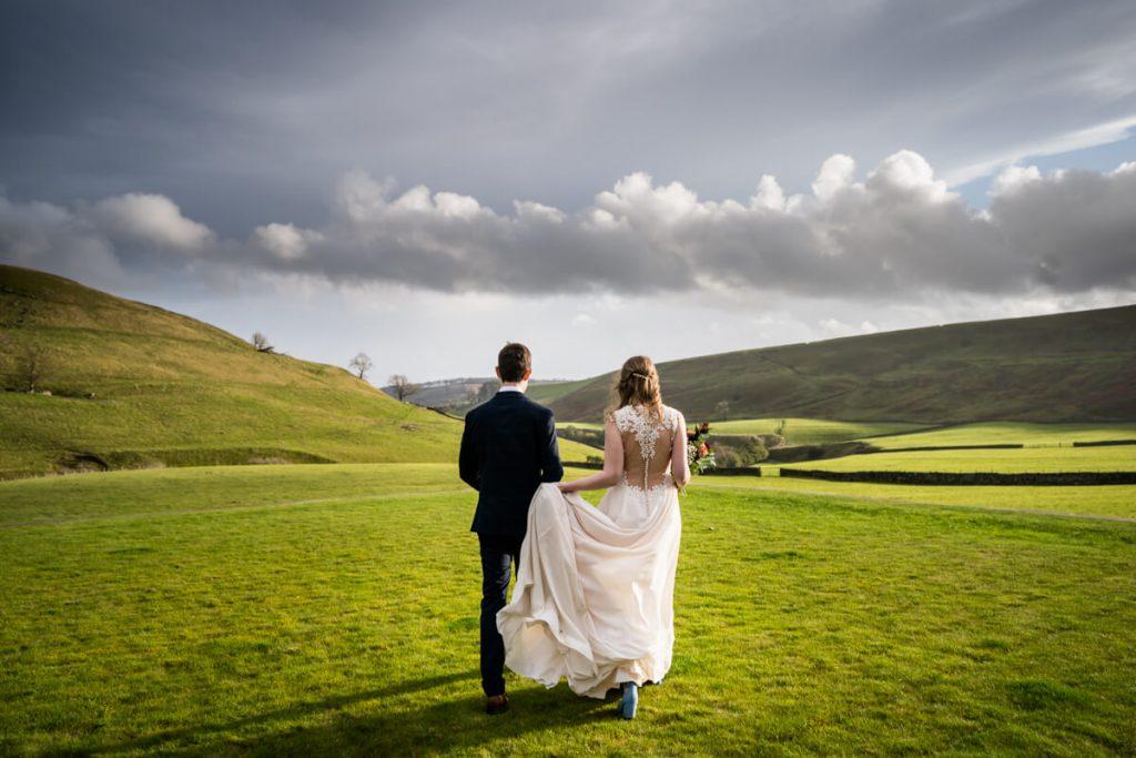telfit farm wedding couple walk in the gardens