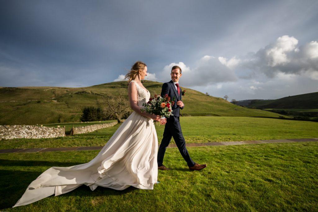 bride and groom stroll in the gardens at telfit farm wedding venue